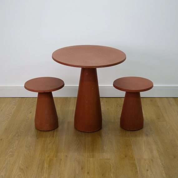 Garden table and stools by Tom Dixon