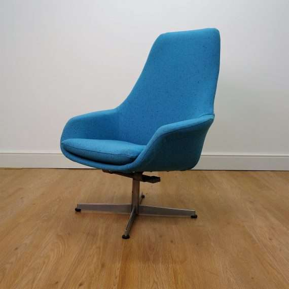 1960s turquoise rocking chair on metal base