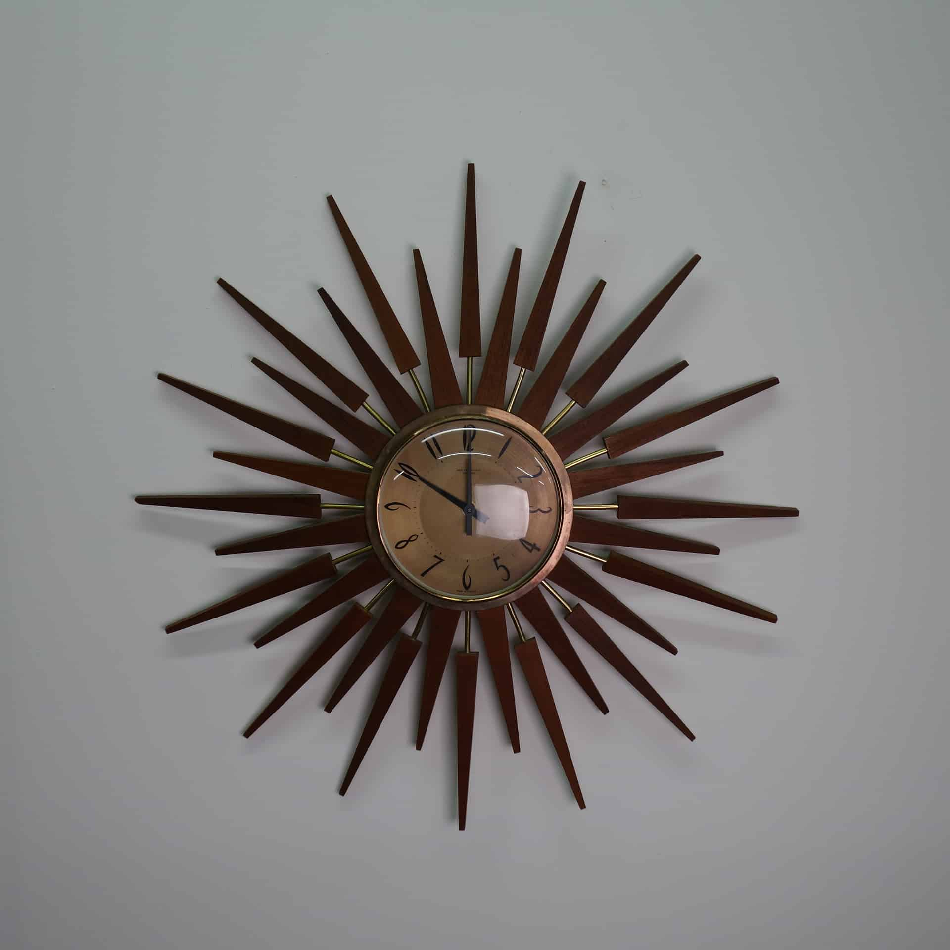 1960s teak star burst clock by Anstey and Wilson