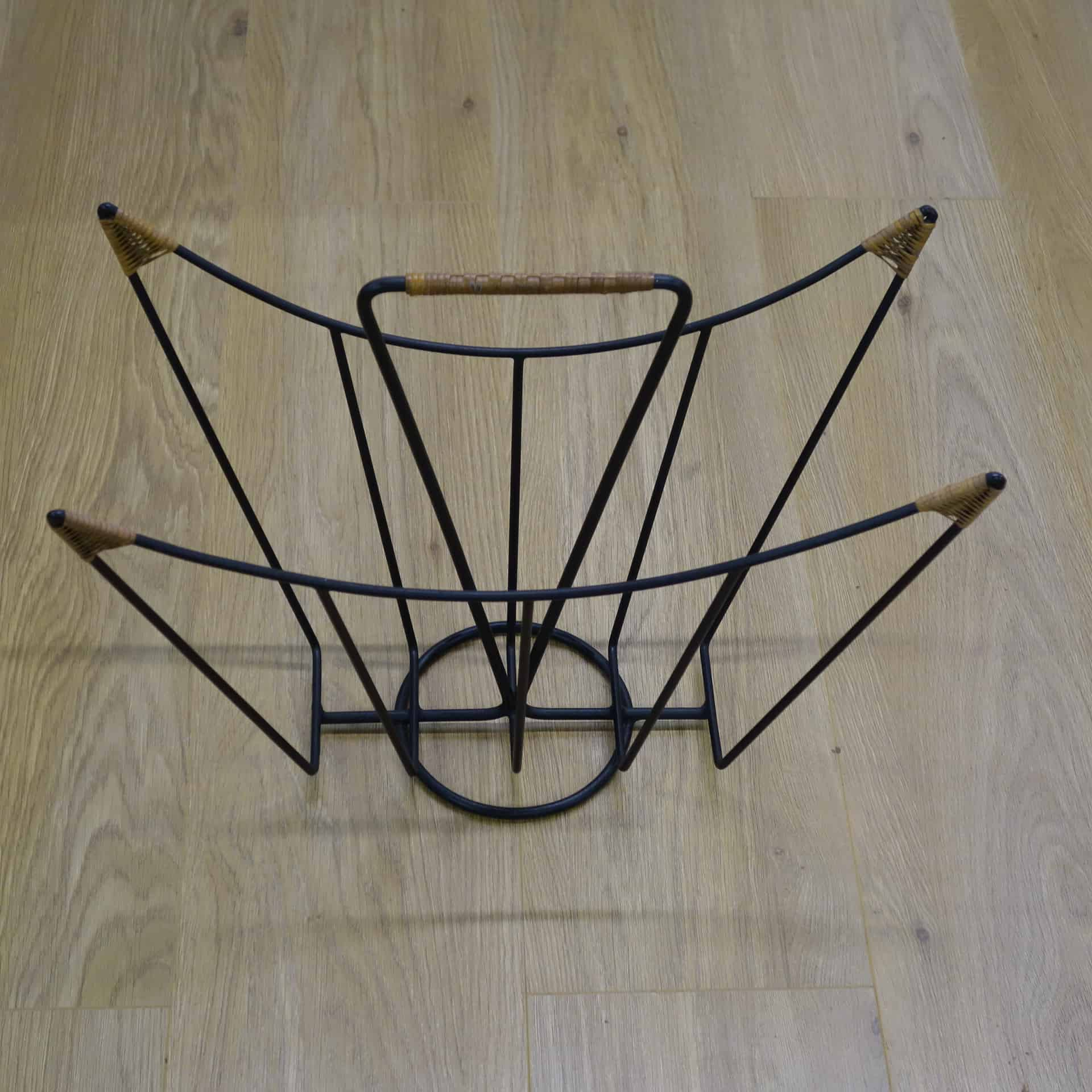 1960s black metal and rattan magazine rack