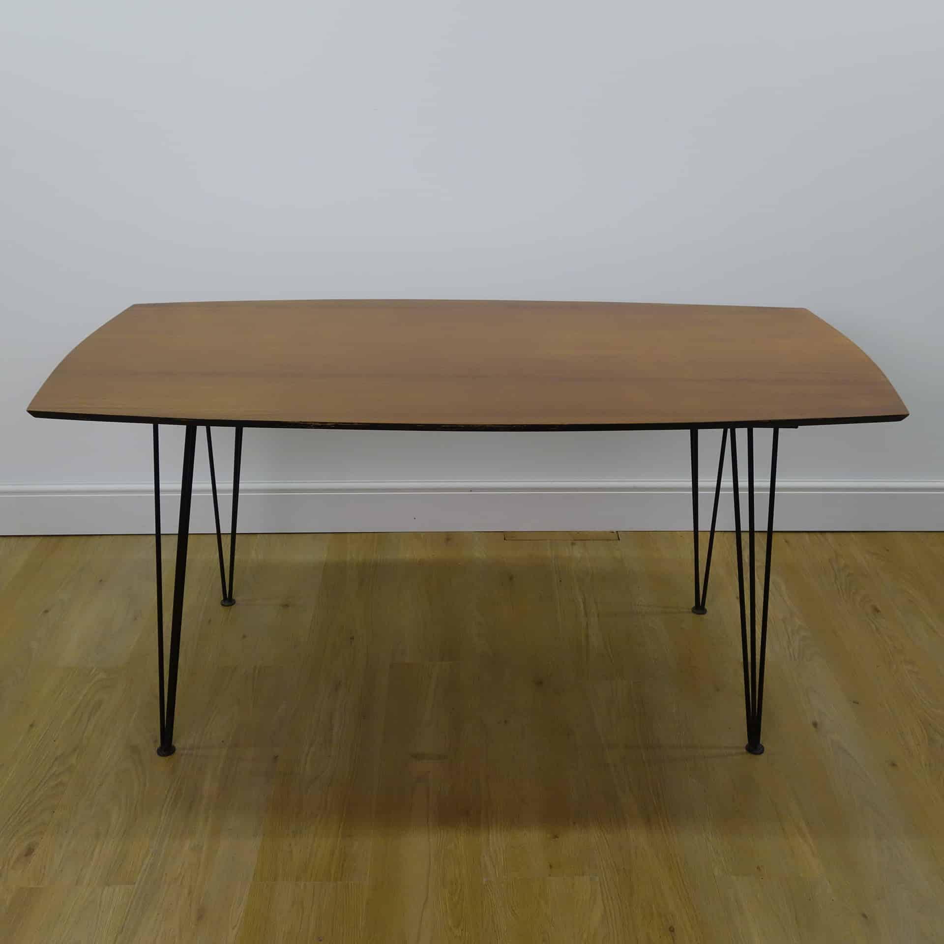 1950s teak dining table on metal triple rod legs