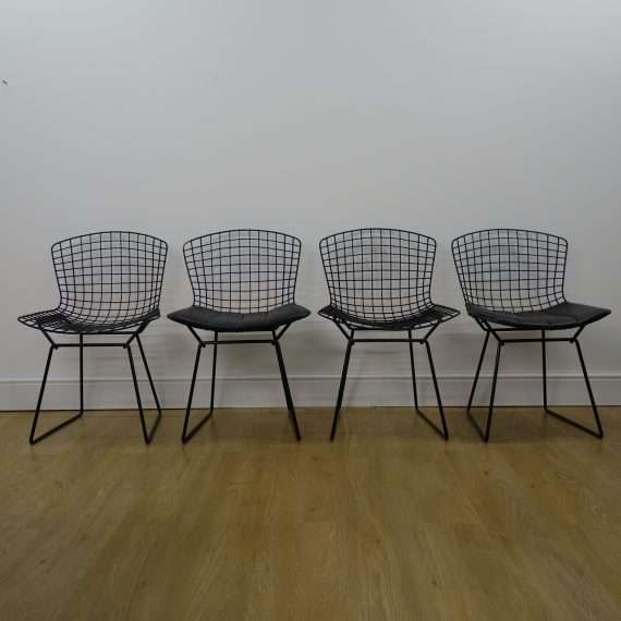 Black wire chairs by Harry Bertoia for Knoll